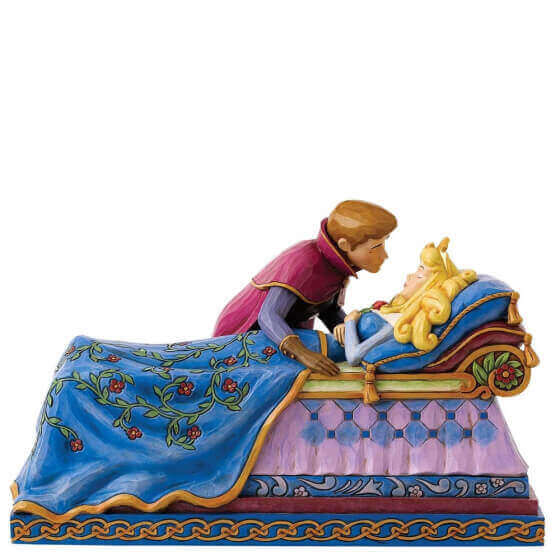 aurora laying in her bed with the prince sitting over her