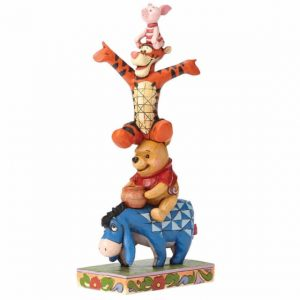 a figurine of Eeyore,Winnie the pooh,piglet and tigger