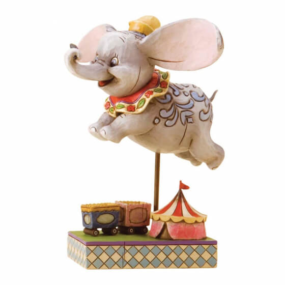 Dumbo flying above the circus
