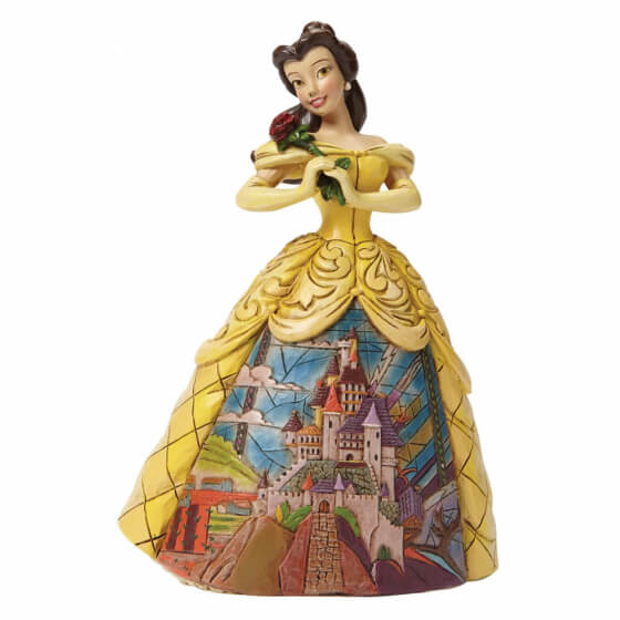 Belle in her yellow dress showing the Disney Castle