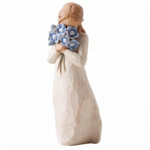 stone resin figurine, lady holding flowers